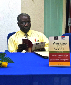 Deputy Principal of UWI Mona Campus Professor Ishenkumba Kahwa browses through the publication.